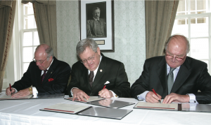 Leaders of the three founding organizations sign the charter creating IEMI on 19 May 2005.